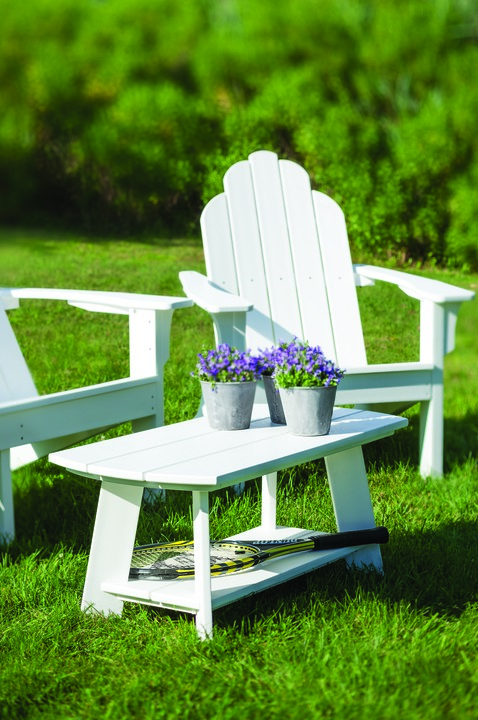 An Adirondack Coffee Table Shown On The Lawn With An Adirondack Chair