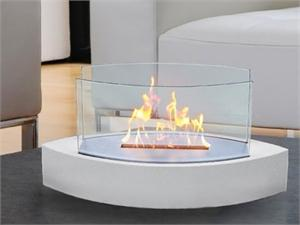 A tabletop fireplace shown in white with glass sides by Anywhere Fireplace.