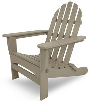 A Polywood Folding Adirondack Chair in Sand Color is shown by itself.