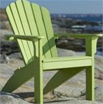 This is a leaf green adirondack chair shown by itself with the ocean behind it