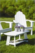An adirondack coffee table shown on the lawn with an adirondack chair by Seaside Casual - GottaHaveItInc.com