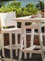 Seaside Casual MAD Bar Chair shown at a MAD Bar Table in White by the water.