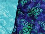 Fabric with a sea turtle in blue and green tones.