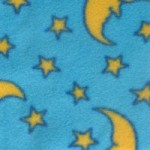 Fabric shown with light blue background and yellow stars and moons